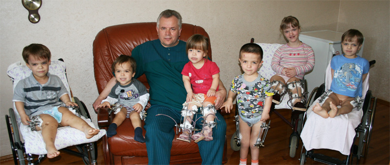 Doctor Vitaliy Veklich and children with 